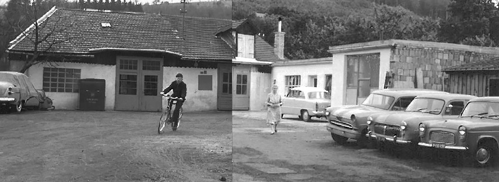 Alte Gebäude und alte Autos auf altem Firmengelände mit Frau im Kleid und Mann auf einem Fahrrad